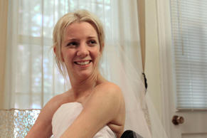 In this June 30, 2011 photo, Rachelle Friedman smiles after trying on her wedding dress in Raleigh, N.C. Friedman was left paralyzed after a swimming pool accident that postponed her wedding plans. Now, she is all set to commence with those plans.