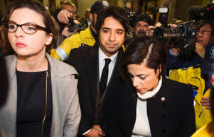 File image of Jian Ghomeshi, centre, a former celebrity radio host who has been charged with multiple counts of sexual assault, as he leaves court alongside his lawyer Marie Henein, right, in Toronto, January 8, 2015.
