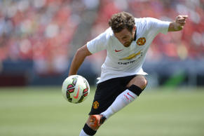 Jul 26, 2014; Denver, CO, USA; Manchester United midfielder Juan Mata (8) kicks and scores in the first half against AS Roma at Sports Authority Field. Mandatory Credit: