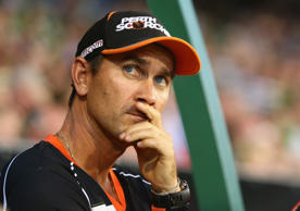 Scorchers coach Justin Langer looks on during the Big Bash League match between the Melbourne Stars and Perth Scorchers at Melbourne Cricket Ground on January 21, 2015 in Melbourne, Australia.