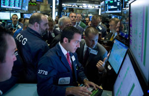 Traders work on the floor of the New York Stock Exchange (NYSE) in New York on Monday, Aug. 11, 2014. Jin Lee/Bloomberg/Getty Images