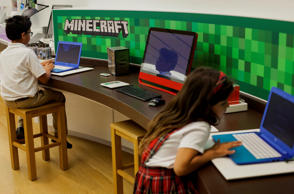 "Children play ""Minecraft"" at a Microsoft Corp. store in Bellevue, Wash., on April 21."