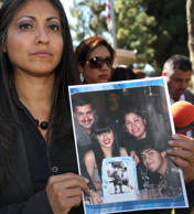 In this Oct. 2, 2014 file photo, attorney Claudia Osuna holds a photo of the Crespo family - from top left to bottom right, Bell Gardens, Calif., Mayor Daniel Crespo, his daughter Crystal, his wife Lyvette and son Daniel Crespo Jr. , during a news conference in Bell Gardens.