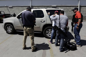 Policemen detain a man on suspicion of being a member of a drug cartel in Guadalajara on Friday. Armed men shot at a Mexican army helicopter in the western state of Jalisco on Friday as the aircraft was forced to make an emergency landing, the Defense Ministry said.