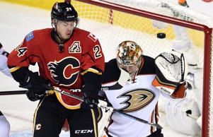 Calgary Flames center Jiri Hudler and Anaheim Ducks goalie Frederik Andersen anticipate a shot in game three of the second round of the 2015 Stanley Cup Playoffs on May 5 in Calgary, Alberta. The Flames won 4-3 in overtime.