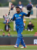 Sri Lanka's Kumar Sangakkara acknowledges his century during the Cricket World Cup match against Scotland in Hobart March 11, 2015.