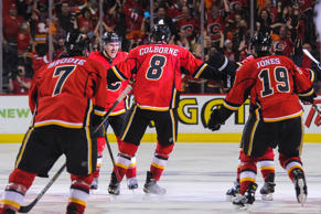 Mikael Backlund #11 of the Calgary Flames scores the game winning goal in overtime against the Anaheim Ducks in Game Three.