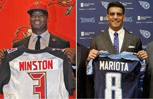 Tampa Bay Buccaneers first-round draft pick Jameis Winston holds up his jersey during a news conference Friday, May 1, 2015, in Tampa, Fla. Winston, former Florida State quarterback, was the first overall pick. Marcus Mariota, former Oregon quarterback and overall No. 2 NFL football draft pick by the Tennessee Titans, poses with with a Titans jersey during a news conference Friday, May 1, 2015, in Nashville, Tenn.