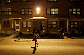 Children play at a party at the public housing complex where Freddie Gray was arrested as a six-day curfew was lifted, Sunday, May 3, 2015, in Baltimore.