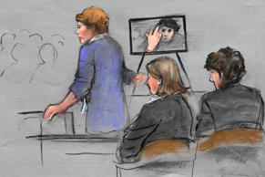 In this courtroom sketch, prosecutor Nadine Pellegrini makes opening arguments during the first day of the penalty phase in the trial of Boston Marathon bomber Dzhokhar Tsarnaev, seated at right, Tuesday, April 21, 2015, in federal court in Boston. Pellegrini displayed a photo to the jury of Tsarnaev extending his middle finger to a security camera taken in his jail cell three months after the attack.
