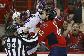 Linesman Bryan Pancich works to separate New York Rangers center J.T. Miller, left, and Washington Capitals right wing Tom Wilson during a scuffle in the first period of Game 4 in the second round of the NHL Stanley Cup hockey playoffs on May 6 in Washington.