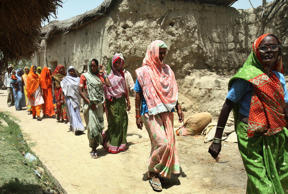 File: Indian women arrive at a polling station to cast their votes, in Amethi, India, on Thursday, April 23, 2009.