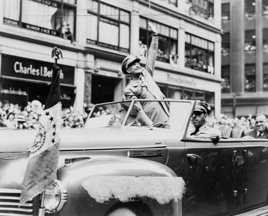 U.S. General Dwight D. Eisenhower waves to the crowd at a parade in the United States in 1945, in this handout photo provided by the United States Library of Congress. Seventy years ago, following the suicide of Nazi leader Adolf Hitler, Germany's head of state Karl Donitz signed his country's surrender to Allied forces in Reims, France on May 7, 1945 and in Berlin on May 8, 1945.