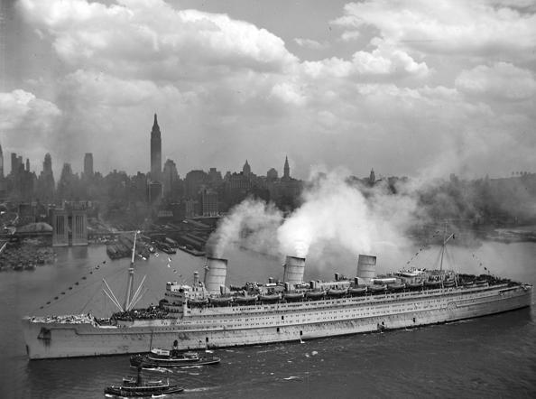 The British liner RMS Queen Mary arrives with thousands of U.S. troops from Europe, in New York harbor on June 20, 1945, in this handout photo provided by the U.S. Navy. Seventy years ago, following the suicide of Nazi leader Adolf Hitler, Germany's head of state Karl Donitz signed his country's surrender to Allied forces in Reims, France on May 7, 1945 and in Berlin on May 8, 1945.