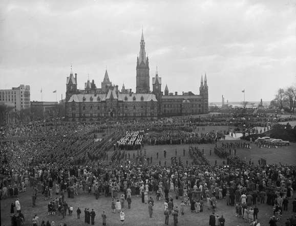 Military personnel and civilians celebrate the VE-Day parade to Parliament Hill in Ottawa, Ontario, May 8, 1945, in this handout photo provided by Library and Archives Canada. Seventy years ago, following the suicide of Nazi leader Adolf Hitler, Germany's head of state Karl Donitz signed his country's surrender to Allied forces in Reims, France on May 7, 1945 and in Berlin on May 8, 1945.