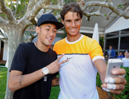 Rafael Nadal (right) of Spain takes a selfie with soccer player Neymar of Barcelona during day three of the Barcelona Open Banc Sabadell at the Real Club de Tenis Barcelona on April 22, 2015, in Barcelona, Spain.