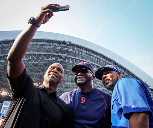 (From left) Former MLB player Carlos Delgado takes a selfie with David Ortiz of the Boston Red Sox and Edwin Encarnacion of the Toronto Blue Jays before a game between the Blue Jays and the Red Sox on May 8, 2015, at the Rogers Centre in Toronto.
