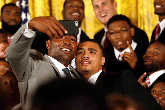 NFL Hall of Famer and former Ohio State Buckeyes player Cris Carter (left) takes a selfie with Buckeyes wide receiver Jalin Marshall after a ceremony to honor the team for winning the national championship on April 20, 2015, in the East Room of the White House.