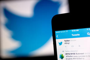 A Twitter Inc. tweet regarding the company ringing the opening bell on the New York Stock Exchange is displayed on an iPhone arranged for a photograph in Washington, D.C.
