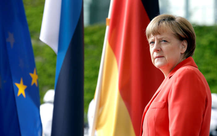 German Chancellor Angela Merkel waits for the arrival of Estonia's President Toomas Hendrik Ilves for a meeting at the chancellery in Berlin, Germany Tuesday, May 19, 2015. (AP Photo/Michael Sohn)
