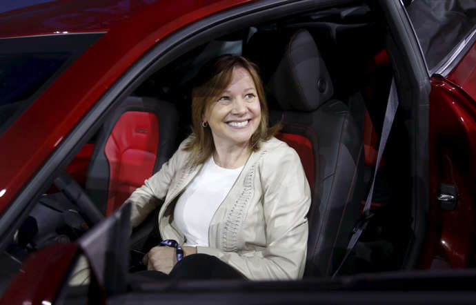 General Motors Co's Chief Executive Officer Mary Barra sits in the driver's seat of the all-new Chevrolet 2016 Camaro SIX during its official debut at Belle Isle in Detroit, Michigan May 16, 2015.  REUTERS/Rebecca Cook - RTX1D9QQ