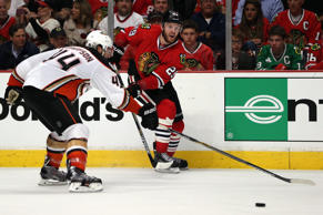 Bryan Bickell #29 of the Chicago Blackhawks passes the puck as Nate Thompson #44 of the Anaheim Ducks defends in Game Three of the Western Conference Finals during the 2015 NHL Stanley Cup Playoffs at the United Center on May 21, 2015 in Chicago, Illinois.