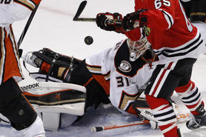 Anaheim Ducks goalie Frederik Andersen watches the puck as he defends the goal against Chicago Blackhawks center Andrew Shaw during the first period in Game 3 of the Western Conference finals of the NHL hockey Stanley Cup playoffs on May 21 in Chicago.