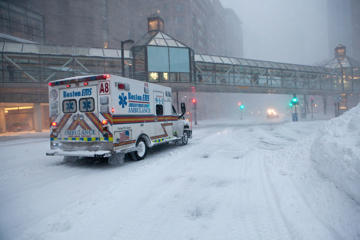 An ambulance patrols the streets of the Back Bay during the blizzard in the early morning on January 27, 2015 in Boston, Massachusetts. Up to three feet of snow is expected to hit eastern Massachusetts as the storm continues throughout the day.   Kayana Szymczak/Getty Images