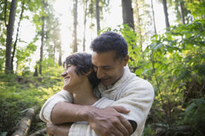 Couple hugging in woods