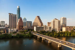Austin, Texas skyline including Congress Avenue bridge over Ladybird Lake.