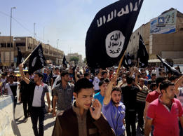 FILE - In this Monday, June 16, 2014 file photo, demonstrators chant pro-Islamic State group slogans as they wave the group's flags in front of the provincial government headquarters in Mosul, 225 miles northwest of Baghdad, Iraq.