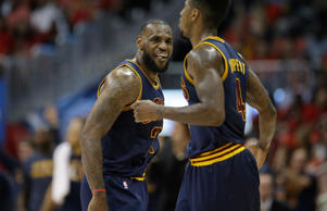 Cleveland Cavaliers forward LeBron James (23) celebrates after Cleveland Cavaliers guard Iman Shumpert (4) made a basket against the Atlanta Hawks during the first half in Game 2 of the Eastern Conference finals of the NBA basketball playoffs, Friday, May 22, 2015, in Atlanta.