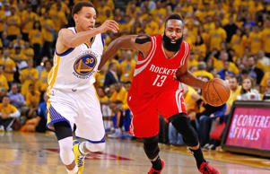 James Harden #13 of the Houston Rockets handles the ball against Stephen Curry #30 of the Golden State Warriors in the second quarter during game two of the Western Conference Finals of the 2015 NBA PLayoffs at ORACLE Arena on May 21, 2015 in Oakland, California.