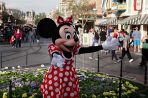 Minnie Mouse entertains visitors at Disneyland in Anaheim, Calif.
