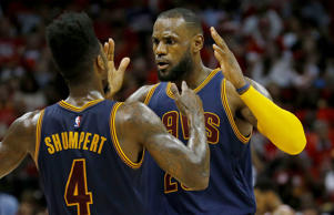 LeBron James #23 celebrates with Iman Shumpert #4 of the Cleveland Cavaliers after scoring in the second quarter against the Atlanta Hawks during Game Two of the Eastern Conference Finals of the 2015 NBA Playoffs at Philips Arena on May 22 in Atlanta.