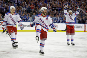 New York Rangers right wing Martin St. Louis, center, celebrates after scoring a goal during the third period of Game 4 of the Eastern Conference finals against the Tampa Bay Lightning, in the NHL hockey Stanley Cup playoffs on Friday in Tampa, Fla.