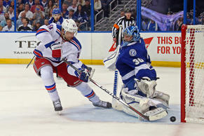 Rick Nash of the New York Rangers scores a goal during the first period against Ben Bishop of the Tampa Bay Lightning in Game Four of the Eastern Conference Finals during the 2015 NHL Stanley Cup Playoffs at Amalie Arena on May 22 in Tampa, Fla.