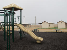 A playground surrounded by cottages that will house immigrants at a new family immigration detention center in Dilley, Texas, Dec. 15, 2014.