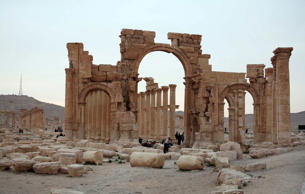 Tourists walk in the historical city of Palmyra, April 14, 2007.