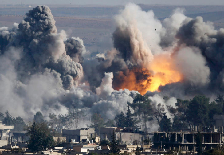 Smoke rises over Syrian town of Kobani after an airstrike, as seen from the Mursitpinar border crossing on the Turkish-Syrian border in the town of Suruc in this file October 18, 2014 file photo. A U.S.-led military coalition has been bombing Islamic State fighters who hold a large swathe of territory in both Iraq and Syria, two countries involved in complex multi-sided civil wars in which nearly every country in the Middle East has a stake.