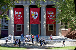 Harvard banners hang from Memorial Church at Harvard University in Cambridge, Ma...
