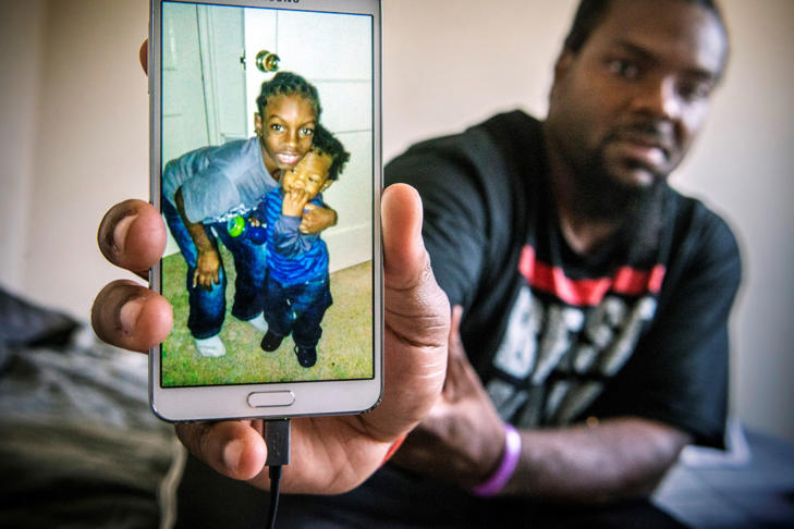 James Lee, the fatherJi'Aire Lee, displays a snapshot of his two sons, Jahmari, 9, and the late Ji'Aire. 3.