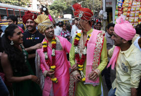 Supporter of the lesbian, gay, bisexual and transgender community dress as grooms of a same-sex marriage during a gay pride parade in Mumbai, India, Saturday, Jan. 31, 2015. Gay rights supporters waved flags and danced during the march to celebrate gay pride and to push for the repeal of a colonial-era law that makes homosexuality a crime. (AP Photo/Rajanish Kakade)