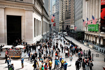 People walk along Wall Street in lower Manhattan on June 5, 2015 in New York City. New numbers which were released by the government today showed that the U.S. economy gained 280,000 jobs in May and over a million new jobs so far in 2015. May's jobs report dispelled fears that the U.S. economy was contracting after the winter slowdown.