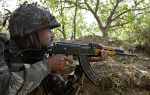 File: An Indian army soldier takes up position on the second day of a gun battle with separatist militants inside a jungle area in Noor Takiya, 25 km (16 miles) south of Srinagar October 7, 2009.