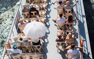 People on a tourist vessel cruise on Spree river in Berlin, Germany.