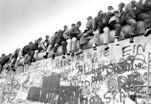 East and West Germans alike clambered to get a look at each other's cities from the top of the Berlin Wall near Potzdamer Platz, Nov. 16 1989.