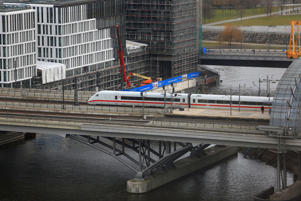 A Deutsche Bahn AG InterCity Express (ICE) train leaves Berlin Central Station.