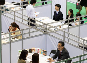 Jobseekers speak with recruitment representatives at a job fair in Goyang, South Korea.