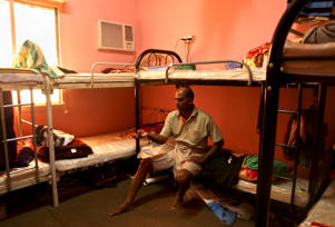 Kuttamon C Velayi shares a room with seven other Indian laborers in Doha.  The housing facility has been cited by Qatari labor officials for substandard conditions.